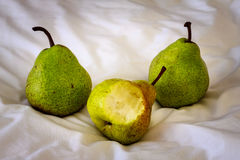 Three pears on a fabric. Stock Photo