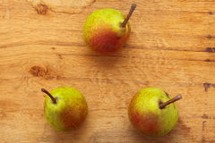 Three pears fruits on wooden table background Stock Photo