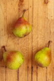 Three pears fruits on wooden table background Royalty Free Stock Photo