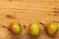 Three pears fruits on wooden table background Royalty Free Stock Photography