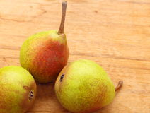 Three pears fruits on wooden table background Royalty Free Stock Photos