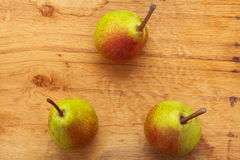 Three pears fruits on wooden table background Royalty Free Stock Image