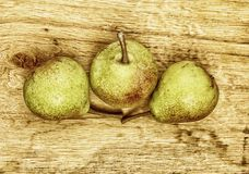 Three pears fruits on wooden table Royalty Free Stock Image