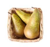 Three Pears In A Small Basket Royalty Free Stock Image