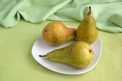 Three pears on the plate. Still life stock photography