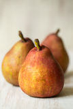 Three Pears In a Row Royalty Free Stock Image