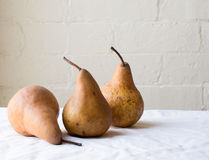 Three pears on table Stock Photography
