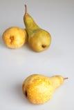 Three pears on white background. Three pears on white plexiglass Stock Image