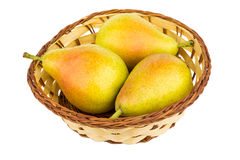 Three pears in wicker basket isolated on white Royalty Free Stock Images