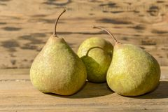 Three pears on wood stock photography