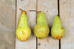 Three pears on wooden background Stock Image
