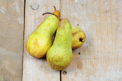 Three pears on wooden background Stock Photos