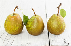 Three pears on wooden background Stock Photography
