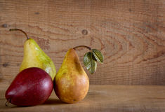 Three pears on a wooden plank Stock Image