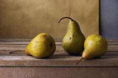 Three pears on wooden table stock images