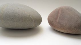Three Pebble Stones in a Row stock footage