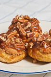 Three pecan croissant rolls with caramel Royalty Free Stock Photo