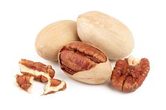 Three pecan nuts isolated on white background royalty free stock images