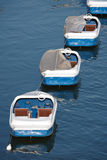 Three pedal boats in a row Stock Images