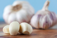 Three peeled garlic cloves Stock Image