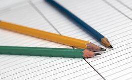 Three pencils. Colored pencils on white paper Stock Image
