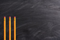 Three Pencils and Blackboard Stock Image