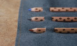 Three pencils in the pencil case. Three wooden pencils in pencil case on the texture Royalty Free Stock Image
