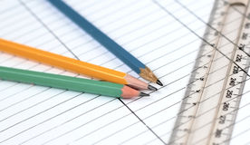 Three pencils an ruler. Colored pencils on white paper Royalty Free Stock Images