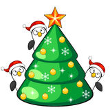 Three penguins and Christmas tree Royalty Free Stock Images