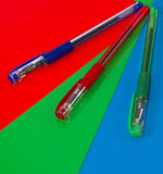 Three pens. On a colored background Royalty Free Stock Images