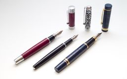 Three pens with caps. Three old pen with caps over white background Stock Images