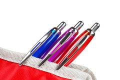 Three pens in a pencil case Royalty Free Stock Photo