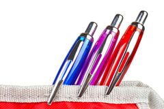 Three pens in a pencil case Royalty Free Stock Photos