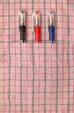 Three pens in shirt pocket Royalty Free Stock Photography