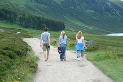Three people. On the road royalty free stock image