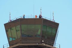 Three people in an airport control tower, lerida royalty free stock images
