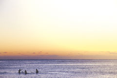 Three People in Beach during Sunset Royalty Free Stock Photography