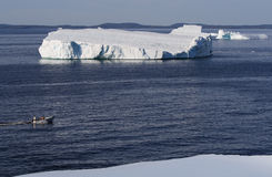 Three People in Boat and Icebergs Stock Photos