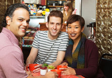 Three People in Cafe Royalty Free Stock Images