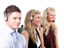 Three people in a call centre. Three working in in a call centre Stock Image
