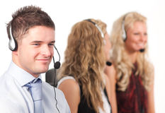 Three people in a call centre. Three working in in a call centre Stock Photography