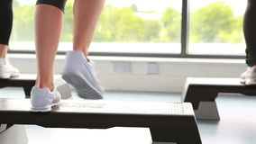 Three people doing aerobics. In gym stock footage