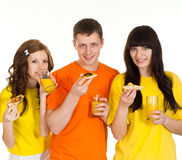 Three people eating pizza Stock Image