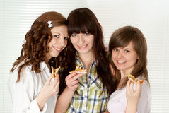 Three people eating pizza Royalty Free Stock Photo