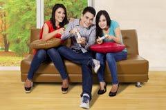 Three people enjoying games Stock Image