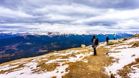 Two senior women enjoying the view on top of The Whistlers mountain in Jasper National Park. Three people enjoying the view on top of The Whistlers mountain in Stock Photo