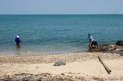Three people fishing. 