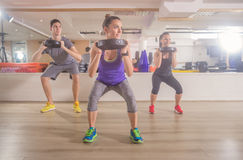 Three people fitness gym squat weights hand Royalty Free Stock Images