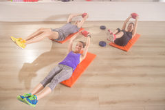Three people fitness mat happy abs core exercise straight arm we. Ights Royalty Free Stock Photo