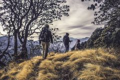 Three People Hiking on High Mountain Royalty Free Stock Photo